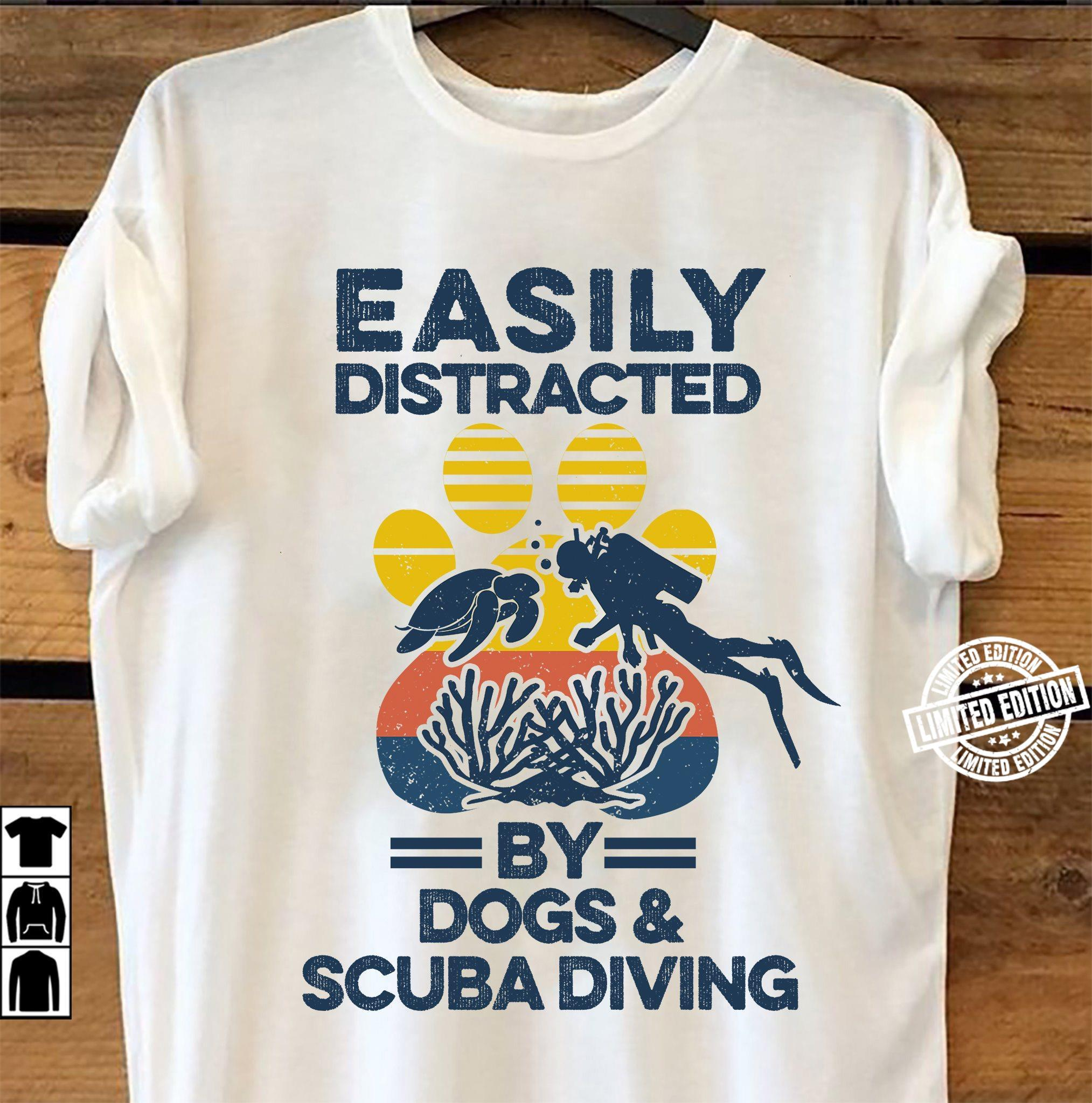 Easily distracted by dogs and scuba diving shirt